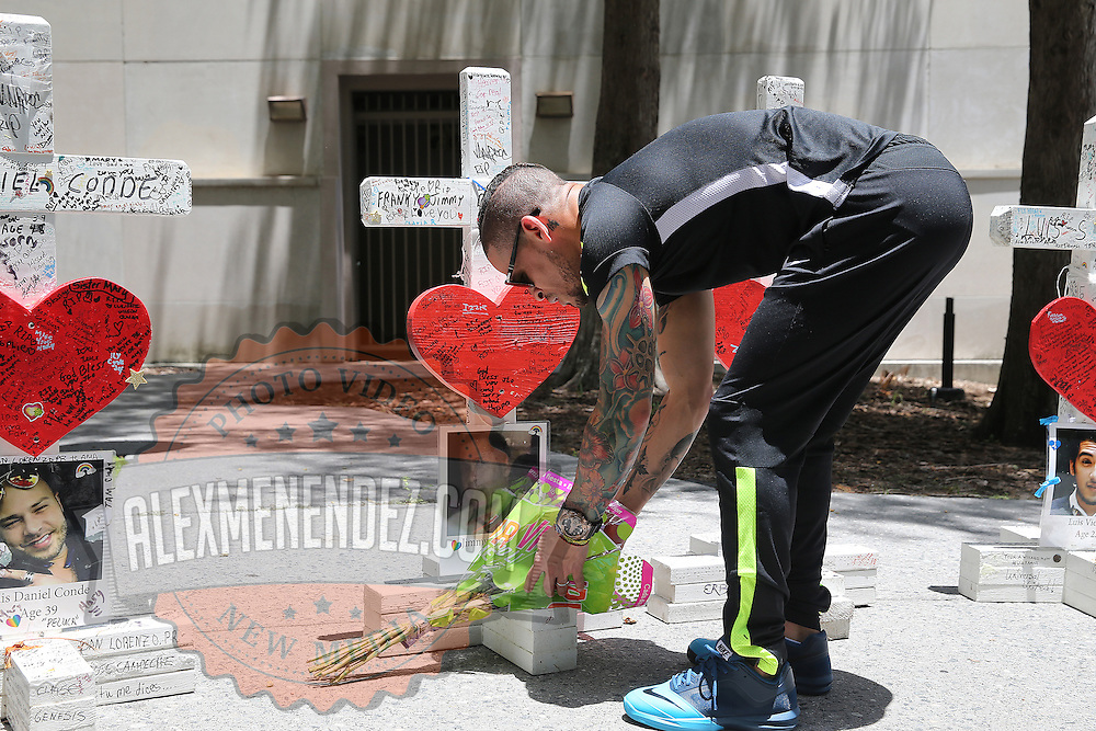 Olympian and professional boxer Orlando Cruz of Puerto Rico pays his respects to the victims of the Pulse Nightclub shooting at the Orange County History Center on Tuesday, July 12, 2016 in Orlando, Florida. Cruz, who lost four friends in the tragic incident was the first openly gay boxer in the sport and will fight for his fifth time in the Orlando area this Friday.  (Alex Menendez via AP)