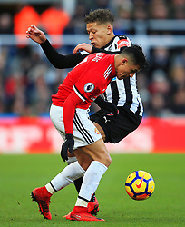 Alexis Sanchez of Manchester United takes on Dwight Gayle of Newcastle United - Mandatory by-line: Matt McNulty/JMP - 11/02/2018 - FOOTBALL - St James Park - Newcastle upon Tyne, England - Newcastle United v Manchester United - Premier League
