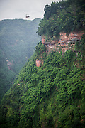 """The panoramic cableway ad the cliff route on the mountain are seen in the Bamboo Sea in Yibin, August 06, 2014.<br /> <br /> Shunan Bamboo Sea (Chinese: 蜀南竹海;pinyin: shǔnánzhúhǎi) covers an area of over 120 kilometers in Sichuan Province.<br /> This forest has won its fame for its unique green and graceful trees: bamboos are here, there and everywhere.<br /> It is one of the shooting places of the Oscar award- winning movie """"Crouching Tiger, Hidden Dragon"""" directed by Ang Lee.<br /> <br /> © Giorgio Perottino"""