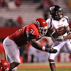 Sep 19, 2009; Piscataway, NJ, USA; Rutgers defensive end George Johnson (31) hits Florida International wide receiver T.Y. Hilton (4) during the second half of Rutgers' 23-15 victory over Florida International at Rutgers Stadium.