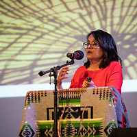 """Bhavani Parpia, Founder and President of Connecteach-International Education Non-Profit, presents """"Global Issues In Education"""" to students and faculties. The """"Education is our Human Right"""" forum was held at the Phil L. Thomas Performing Arts Center in Shiprock on Thursday."""