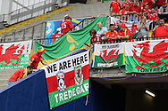 Wales fans hang up their flags in the Stadium before the game. . UEFA Euro 2016, group B , England v Wales at Stade Bollaert -Delelis  in Lens, France on Thursday 16th June 2016, pic by  Andrew Orchard, Andrew Orchard sports photography.
