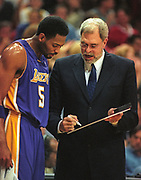 Feb 18, 2000; Orlando, Florida, USA; Head Coach Phil Jackson of the Los Angeles Lakers explaining a play to Robert Horry against the Orlando Magic at the TD Waterhouse Centre in Orlando.  The Lakers beat the Orlando Magic 107-99.