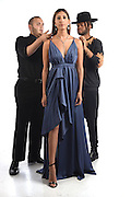 Hartford, CT, 8/25/2016<br /> Fashion designer Matthew Reisman of Middletown, left, and his husband and stylist Reginald Reisman, right, make fitting adjustments to a dress modeled by Gabby Didato of Middlefield.<br /> Photo by MARA LAVITT/ Special to the Courant.