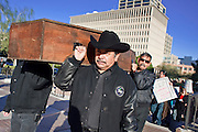 """05 DECEMBER 2009 -- PHOENIX, AZ: Pallbearers carry the coffin of """"free speech"""" to the Maricopa County Board of Supervisors meeting in Phoenix Monday. About 200 people from several Phoenix area civil rights groups held a mock """"funeral"""" for civil rights in Phoenix Monday to protest actions taken by the Maricopa County Board of Supervisors recent decisions that limit protestors' ability to speak out against Sheriff Joe Arpiao during Board of Supervisors meetings. The protestors have been attending meetings to protest the Sheriff's series of anti-immigrant sweeps in Latino neighborhoods of Phoenix. Photo by Jack Kurtz / ZUMA Press"""