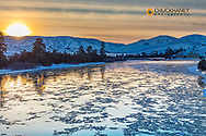 Ice flows on cold day at sunset on The Flathead River after a fresh snowfall in the Mission Valley, Montana, USA