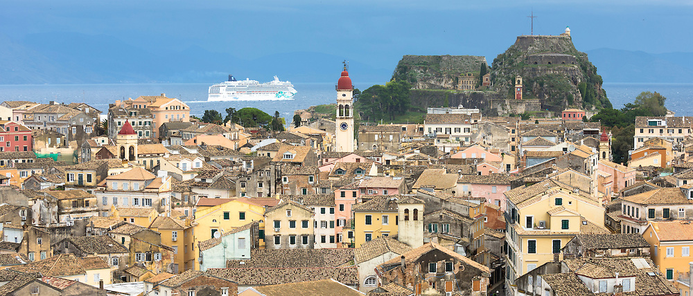 Kerkyra, Corfu Town and Old Fort with Norwegian Jade cruise liner ship in Ionian Sea in Corfu, Ionian Islands, Greece