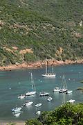 High angle view of sea with boats, Port de Girolata, Corsica, France
