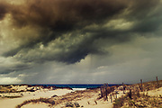 Rain and thunderstorm over the ocean and wind in the dunes