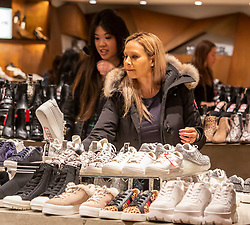 © Licensed to London News Pictures. 26/12/2019. . Looking for a designer bargain at the Shoe Emporium in Selfridges as Boxing Day bargain hunters brave the cold and the rain in Oxford Street for a chance to get large discounts on designer items at Selfridges this morning . Alex Lentati/LNP