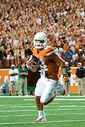 AUSTIN, TX - AUGUST 30:  David Ash #14 of the Texas Longhorns rushes for a 1 yard touchdown against the North Texas Mean Green during the 2nd quarter on August 30, 2014 at Darrell K Royal-Texas Memorial Stadium in Austin, Texas.  (Photo by Cooper Neill/Getty Images) *** Local Caption *** David Ash