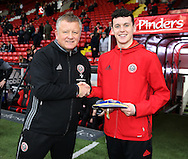 Chris Wilder manager of Sheffield Utd presents  with his U17 Irish football cap during the English League One match at Bramall Lane Stadium, Sheffield. Picture date: December 10th, 2016. Pic Simon Bellis/Sportimage