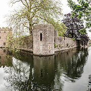 High resolution panorama of the moat and guard towers of the Bishop's Palace in Wells, Somerset, England.
