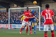 AFC Wimbledon striker James Hanson (18) battles for possession with Charlton Athletic defender Ben Purrington (16) during the EFL Sky Bet League 1 match between AFC Wimbledon and Charlton Athletic at the Cherry Red Records Stadium, Kingston, England on 23 February 2019.