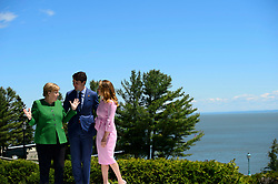 Prime Minister Justin Trudeau and wife Sophie Gregoire Trudeau greet German Chancellor Angela Merkel during the official welcoming ceremony at the G7 Leaders Summit in La Malbaie, Quebec, Canada on Friday, June 8, 2018. Photo by Sean Kilpatrick/CP/ABACAPRESS.COM