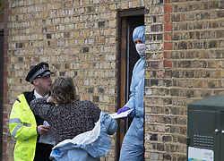 FILE PICTURE © Licensed to London News Pictures. 21/09/2017. London, UK. Police in protective clothing are seen at a house belonging to Sabrina Kouider and her partner Ouissem Medouni where police and the fire brigade attended and found the burnt body of their nanny Sophie Lionnet in the garden in Wimbledon, south London. Kouider and Medouni, who are both French nationals, deny murder but have admitted perverting the course of justice by burning the body. Photo credit: Peter Macdiarmid/LNP