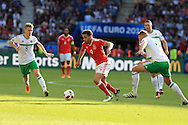 Hal Robson-Kanu of Wales © goes past Gareth McAuley ® and Steven Davies of Northern Ireland. UEFA Euro 2016, last 16 , Wales v Northern Ireland at the Parc des Princes in Paris, France on Saturday 25th June 2016, pic by  Andrew Orchard, Andrew Orchard sports photography.