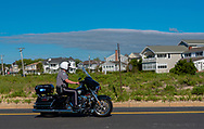 Spring Lake, NJ USA -- May 27, 2017  Police officer rides a motorcycle along Ocean Avenue the morning of the Spring Lake 5 Mile Race. Editorial Use Only
