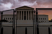 WASHINGTON, DC - JANUARY 17: Security fencing surrounds the U.S. Supreme Court which is adjacent to the U.S. Capitol on the morning of January 17, 2021 in Washington, DC. After last week's riots at the U.S. Capitol Building, the FBI has warned of additional threats in the nation's capital and in all 50 states. According to reports, as many as 25,000 National Guard soldiers will be guarding the city as preparations are made for the inauguration of Joe Biden as the 46th U.S. President.