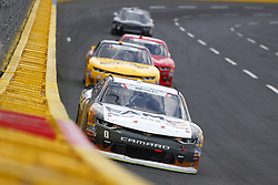 May 26, 2018 - Concord, North Carolina, United States of America - Garrett Smithley (0) brings his car through the turns during the Alsco 300 at Charlotte Motor Speedway in Concord, North Carolina. (Credit Image: © Chris Owens Asp Inc/ASP via ZUMA Wire)