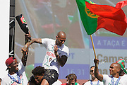 Portuguese player William Carvalho drenches RIcardo Quaresma with beer while celebrating with supporters at Alameda Dom Afonso Henriques, in Lisbon. Portugal's national squad won the Euro Cup the day before, beating in the final France, the organizing country of the European Football Championship, in a match that ended 1-0 after extra-time.