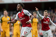 Alex Iwobi Of Arsenal (l) celebrates after he scores his teams 2nd goal. <br /> Premier league match, Arsenal v Brighton & Hove Albion at the Emirates Stadium in London on Sunday 1st October 2017. pic by Kieran Clarke, Andrew Orchard sports photography.