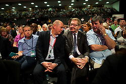 © Licensed to London News Pictures. 27/09/2015. Brighton, UK. STEVE TURNER (second left) and LEN MCCLUSKEY (second right) of UNITE union attend the opening session on day one. Day one of the 2015 Labour Party Conference, held at the Brighton Centre in Brighton, East Sussex. This years conference takes place just weeks after Jeremy Corbyn was elected leader of the party. Photo credit: Ben Cawthra/LNP
