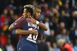September 30, 2017 - Paris, France - Paris Saint-Germain's Brazilian forward Neymar embraces Paris Saint-Germain's French forward Kylian Mbappé Lottin (R) during the French L1 football match between Paris Saint-Germain and Bordeaux at the Parc des Princes stadium in Paris on September 30, 2017. (Credit Image: © Geoffroy Van Der Hasselt/NurPhoto via ZUMA Press)