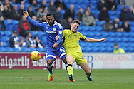 Cardiff City's Junior Hoilett (r) is challenged by Rotherham's Richard Smallwood. EFL Skybet championship match, Cardiff city v Rotherham Utd at the Cardiff city stadium in Cardiff, South Wales on Saturday 18th February 2017.<br /> pic by Carl Robertson, Andrew Orchard sports photography.
