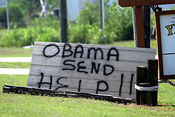 05 May 2010. Boothville, Louisiana. Deepwater Horizon, British Petroleum environmental oil spill disaster.<br /> A sign along the road in Plaquemines parish in the small delta town of Boothville begs for President Obama's help.<br /> Photo credit;Charlie Varley/varleypix.com