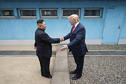 June 30, 2019 - Panmunjom, South Korea - U.S President Donald Trump and North Korean leader Kim Jong Un shake hands as they meet at the border in the Demilitarized Zone June 30, 2019 in Panmunjom, South Korea. (Credit Image: © Shealah Craighead via ZUMA Wire)