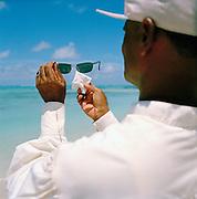 Sunglasses cleaner on a beach, Mauritius
