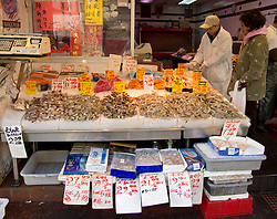 Seafood shop in traditional food market in Chinatown Manhattan New York City USA