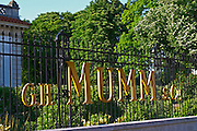 A wrought iron fence and golden letters in the setting sun at Champagne G.H. Mumm, Reims, Champagne, Marne, Ardennes, France