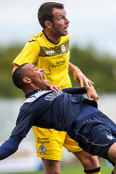 Queen of the South's Andy Dowie holds Falkirk's Phil Roberts.<br /> Falkirk 2 v 1 Queen of the South, Scottish Championship 5/10/2013, played at The Falkirk Stadium.<br /> ©Michael Schofield.