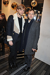 Left to right, CHRISTOPHER DE VOS and PETER PILOTTO at a party to celebrate the launch of a limited edition shoe The Chambord in celebration of Nicholas Kirkwood's partnership with Chambord black raspberry liqueur, held at the Nicholas Kirkwood Boutique, 5 Mount Street, London on 12th December 2012.