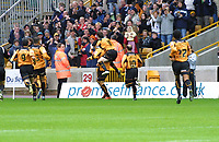 Photo: Dave Linney.<br />Wolverhampton Wanderers v Norwich City. Coca Cola Championship. 05/11/2005. The Chase is on to catch Wolves goalscorer  Seol Ki-Hyeon as  Capt Mark Kennedy<br />hitches a ride.