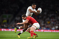 Anthony Watson of England is tackled by George North of Wales. Rugby World Cup 2015 pool A match, England v Wales at Twickenham Stadium in London, England  on Saturday 26th September 2015.<br /> pic by  Andrew Orchard, Andrew Orchard sports photography.
