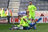 Stephen Warnock of Wigan Athletic (l) and Will Atkinson of Southend United challenge for the ball. Skybet football league one match , Wigan Athletic v Southend Utd at the DW Stadium in Wigan, Lancs on Saturday 23rd April 2016.<br /> pic by Chris Stading, Andrew Orchard sports photography.