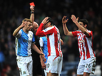 Stoke City's Geoff Cameron (centre) is shown a red card by referee Anthony Taylor for a foul on Blackburn Rovers' Joshua King<br /> <br /> Photographer Kevin Barnes/CameraSport<br /> <br /> Football - The FA Cup Fifth Round - Blackburn Rovers v Stoke City - Saturday 14th February 2015 -  Ewood Park - Blackburn<br /> <br /> © CameraSport - 43 Linden Ave. Countesthorpe. Leicester. England. LE8 5PG - Tel: +44 (0) 116 277 4147 - admin@camerasport.com - www.camerasport.com