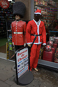 Grenadier guardsman mannequin and faceless Santa in London's Oxford Street.