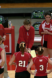 09 OCT 2005 Redbird Coach Sharon Dingman does some instructional motivation during a time out. The Illinois State University Redbirds hosted arch rival Bradley University Braves.  The Redbirds soared over the Braves, taking the match in 4 games, losing only game number 2.  Action included play by Braves Star Lindsey Stalzer who is ranked no. 7 in the nation in kills per game.  The first defeat of the conference season for the Braves took place at Redbird Arena on Illinois State's campus in Normal IL.