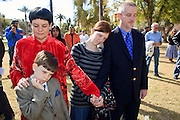 Feb. 14, 2009 -- PHOENIX, AZ: JULIE MILLER and her family, J. MILLER, 7, GABRIELLE MILLER, 16, and husband, JEREMY MILLER, from Anthem, AZ, pray during a peace vigil at the Arizona State Capitol Saturday. Arizona Statehood Day was admitted to the United States on Feb 14, 1912. Anti-war activists in Arizona marked the day this year with a peace vigil at the state capitol.  Photo by Jack Kurtz / ZUMA Press