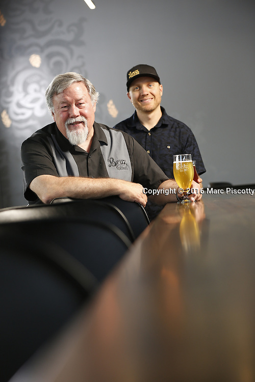 SHOT 7/22/16 2:01:53 PM - Bruz Beers co-founders Charlie Gottenkieny and Ryan Evans inside the new brewery near 67th Avenue and Pecos in Denver, Co. Bruz Beers is Denver's artisanal Belgian-style brewery, featuring a full line of traditional and Belgian-inspired brews, hand-crafted in small batches. Includes images of Evan's dog 'Cooper' as well who serves as the brewery dog. (Photo by Marc Piscotty / © 2016)