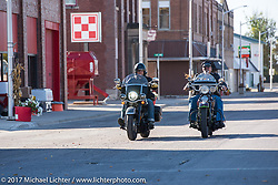 HOG Magazine editor Matt King on a 2018 Harley-Davidson Heritage Classic with it's Milwaukee-8 engine in the new Softail frame riding beside Carl Olsen of Carl's Cycle in Aberdeen riding his 1936 EL Harley-Davidson Knucklehead after a stop in Groton, SD for a flag raising ceremony during the USS South Dakota submarine flag relay across South Dakota. USA. Sunday October 8, 2017. Photography ©2017 Michael Lichter.
