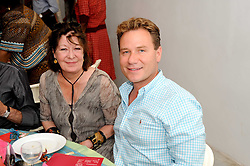 ROBERTA TAYLOR and RICHARD ARNOLD at a charity lunch organised in aid of ASAP (African Solutions to African Problems) held at the Louise T Blouin Foundation, 3 Olaf Street, London W11 on 23rd June 2010.