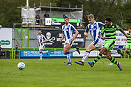 Forest Green Rovers Kaiyne Woolery(14) shoots at goal, saved by Chester's goalkeeper Alex Lynch(1) during the Vanarama National League match between Forest Green Rovers and Chester FC at the New Lawn, Forest Green, United Kingdom on 14 April 2017. Photo by Shane Healey.