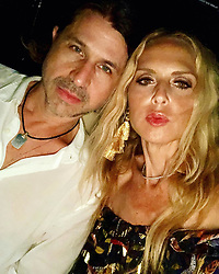 """Rachel Zoe releases a photo on Instagram with the following caption: """"Full moon date tonight with my \u2764\ufe0f @rbermanus \ud83c\udf1a #summernights #heatwave\ud83d\udd25 xoRZ"""". Photo Credit: Instagram *** No USA Distribution *** For Editorial Use Only *** Not to be Published in Books or Photo Books ***  Please note: Fees charged by the agency are for the agency's services only, and do not, nor are they intended to, convey to the user any ownership of Copyright or License in the material. The agency does not claim any ownership including but not limited to Copyright or License in the attached material. By publishing this material you expressly agree to indemnify and to hold the agency and its directors, shareholders and employees harmless from any loss, claims, damages, demands, expenses (including legal fees), or any causes of action or allegation against the agency arising out of or connected in any way with publication of the material."""