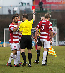 Hamilton's Jonathan Page tackles Falkirk's Lyle Taylor and gets a red card from Referee William Collum..Hamilton 1 v 2 Falkirk, Scottish Cup quarter-final, Saturday, 2nd March 2013..©Michael Schofield.