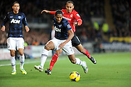 Antonio Valencia of Manchester United is challenged by Peter Odemwingie of Cardiff City.<br /> Barclays Premier League match, Cardiff city v Manchester Utd at the Cardiff city stadium in Cardiff, South Wales on Sunday 24th Nov 2013. pic by Phil Rees, Andrew Orchard sports photography,